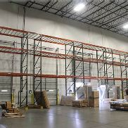 9 SECTION OF OVER-DOCK-DOOR PALLET RACKS,
