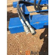 Sweeper brush hydraulically driven