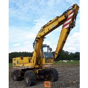 Wheel excavator Faun FM 1024 with openwork grapple, tray, closed grapple