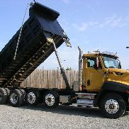 2013 Cat CT660 quad heavy axle dump truck with 475hp, automatic, and 110k miles