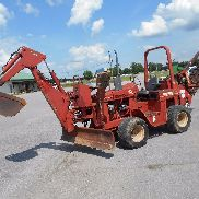 Ditch Witch 4010 with Rock Tooth Trencher and Bcakhoe