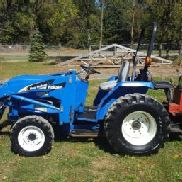 NH TC 30 Compact Loader Tractor W/Woods 7500 Backhoe