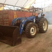 Ford New Holland TN110 Traktor mit Loader 110PS in Arbeitsbedingungen