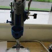 Dremel '220' Drill press & Toolholder For stationary work. Drill vertically or in an angle, adjustable in increments of ...