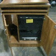 "8 peices of furniture to include: (7) each television stands on casters, each measures 24""X32""X40.4"", some light damage,"
