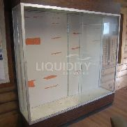 "2 Ea Glass display cases. Sliding glass doors. Estimated dimensions: 72"" X 16"" X 80"". Total weight estimated. 48 hour r"