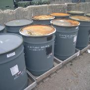 13,200 lbs approx. of Fired 20mm brass casings. Property is stored in 10 metal drums on pallets which are included in
