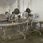 1 - WS Packaging Group, Inc. ASD50 LH Clamhell Trayverpackungen Etikettierer