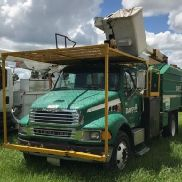 Lift-All Over-Center Bucket Truck mounted behind cab on 2002 Sterling M7500 Chipper Dump Truck (123861)