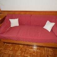 Sofa with cover and 2 pcs. Cushions