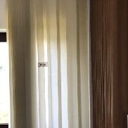 2 slatted curtains