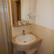 Bathroom-washbasin with mirror and lighting