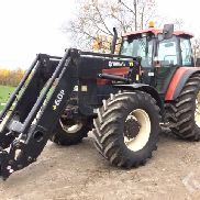 New Holland M135 Tractor with loader & new tires - 97