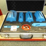 Diamond tipped hole saw set with 6 hole saws, arbours, 150mm diamond disc and wheeled carry case