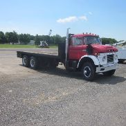 Ford Custom 850 T/A Flatbed Truck