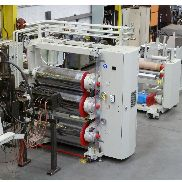 1000mm Omv co-extrusion line. 100mm extruder, 750mm die, coextruder. 1000mm OMv 3 roll stack haul off and winder.