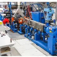 1200mm wide Amut sheet line for edge banding, with Moretto dryers, 100mm Amut extruder, 3 roll stack, haul off and 4 station winder. 2009