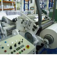 1000mm Bone slitter / rewinder. 7 station helical slitters.