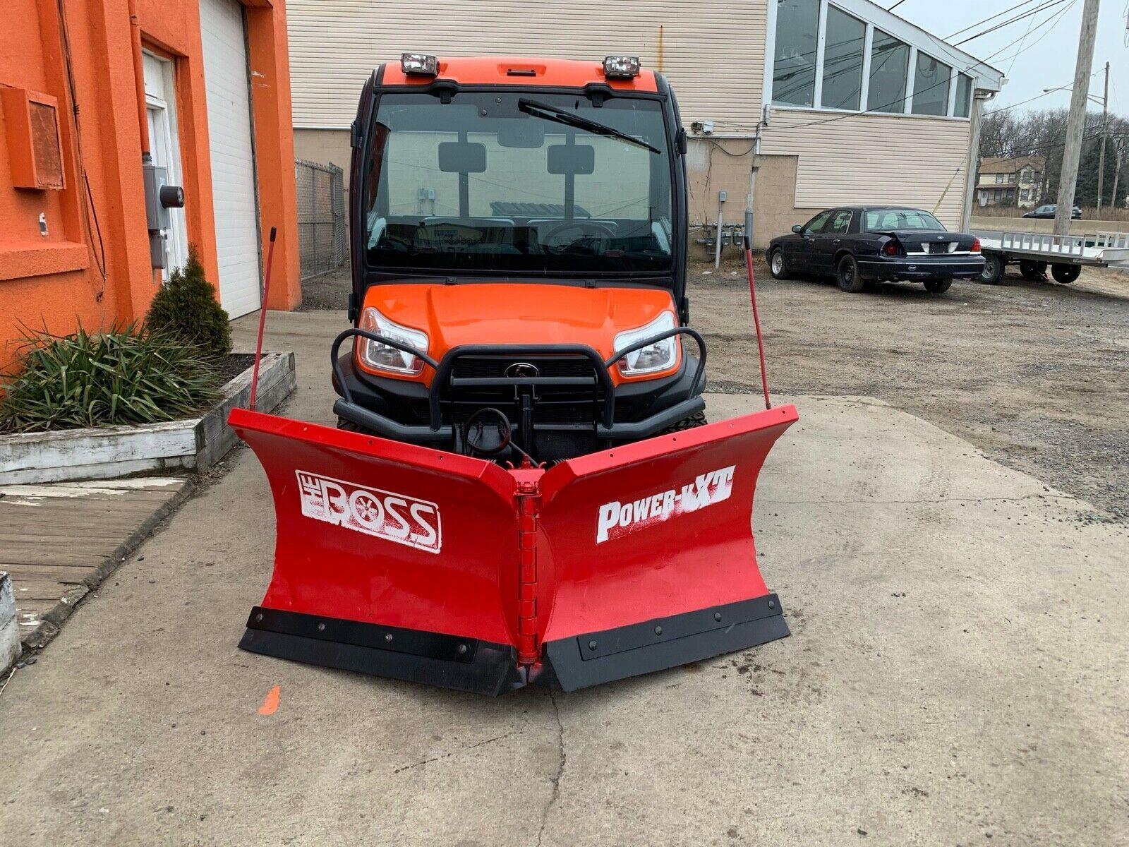 Geladener Kubota RTV X1100C 4x4 Orange Arbeitsbereich BOSS V Hydraulikpflug, AC / HEAT